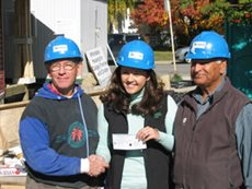 Brian Gancheff and Lal Narang of Calgary Elks with Jeannie Bird of Habitat, Calgary